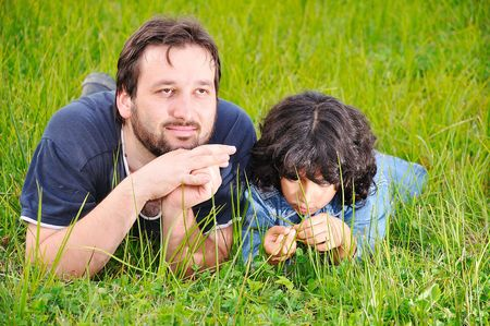 Young father and little cute girl, happiness on meadow Stock Photo - 5555140