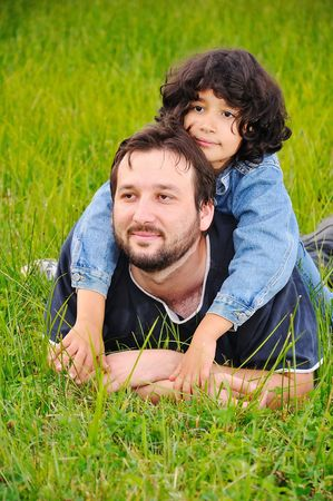 Young father and little cute girl, happiness on meadow Stock Photo - 5555139