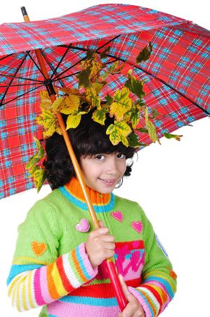 Very cute little girl in autumn clothes isolated photo