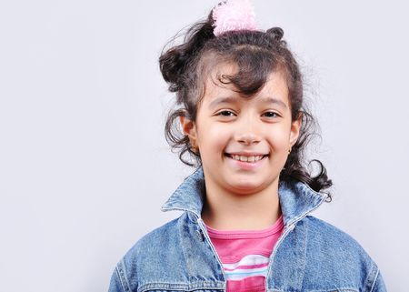 Happy beautiful school girl in studio Stock Photo - 5555189