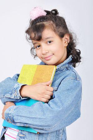Happy beautiful school girl in studio Stock Photo - 5555095