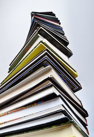A big tower of many books vertical photo