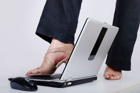 Female leg with hills standing on laptop photo