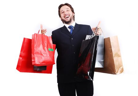 Young attractive man wearing suit and holding shopping bags Stock Photo - 5610870