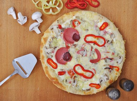 A hot, delicious  pizza with hot and bubbly cheese  photo