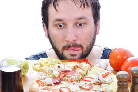 Adult person with surprised face on pizza table photo