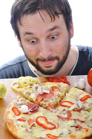 unhealthy lifestyle: Adult person with surprised face on pizza table