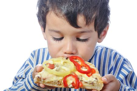 Cute little boy eating pizza, isolated photo