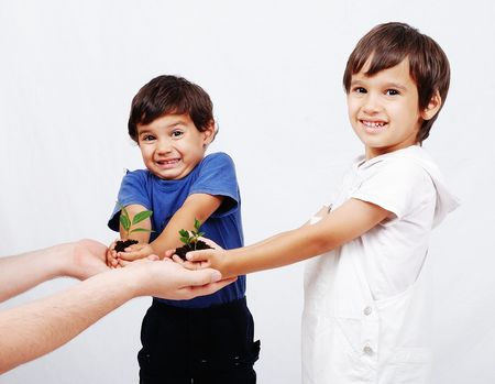 Save our earth, two boys with plant in hands photo
