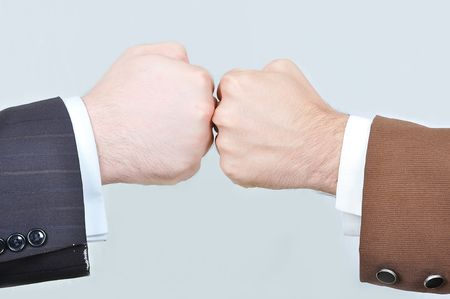 joining forces: Two hands against Stock Photo