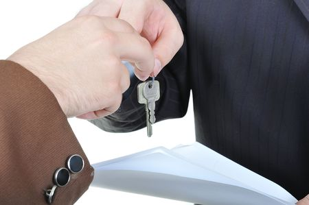 Two businessmen hands and the key, paper agreement photo