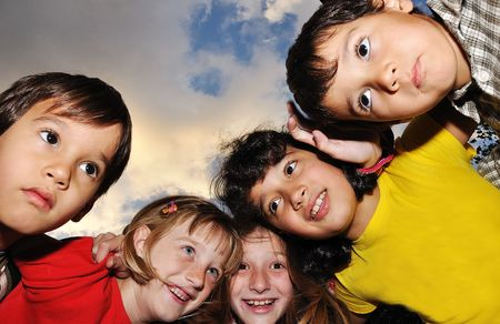 Small group of happy children outdoor photo