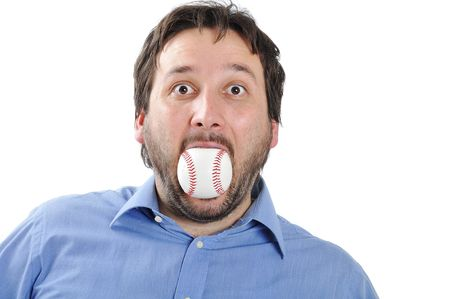 Young man with baseball ball in mouth Stock Photo - 5678840