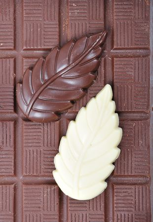 Chocolate, table, pieces, on white background photo