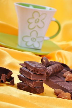 Chocolate, table, pieces, on golden background photo