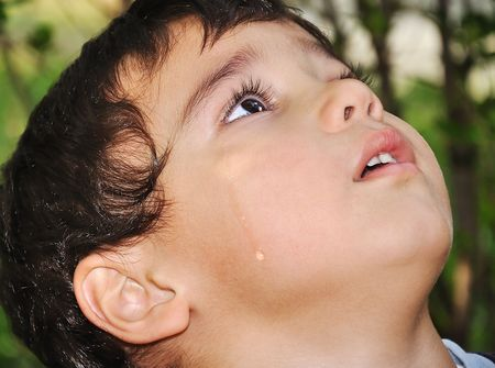 Very cute kid crying with true emotional tears photo