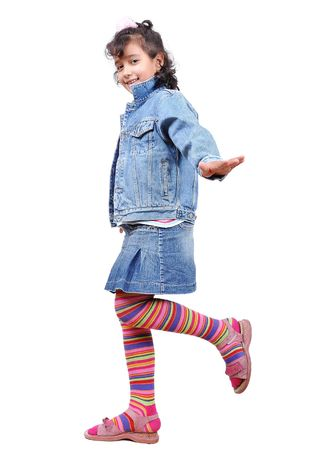 A little cute girl standing isolated Stock Photo - 5678709