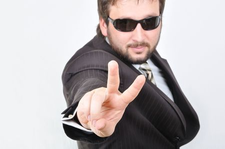 Young attractive man with v-shaped fingers photo
