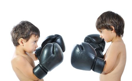 play boy: Two children are fighting with boxing gloves