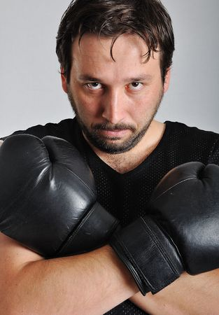 Young man with black boxing gloves photo