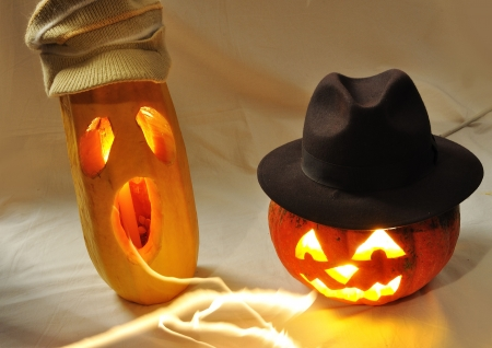 The carved face of pumpkin glowing on Halloween photo