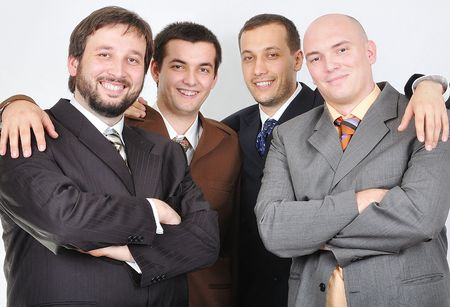 Group of young businessmen together on light background photo