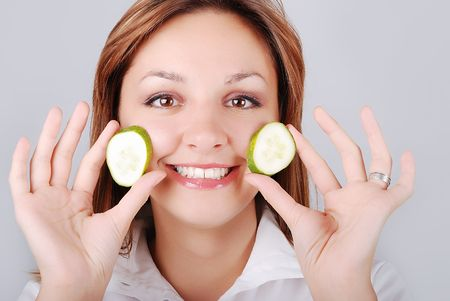 Very nice girl with cucumber  in cute pose photo