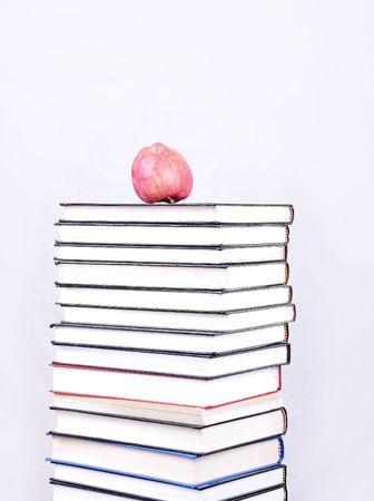 Many books with an apple on photo