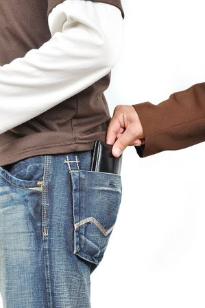 unconcerned: Stealing from back pocket Stock Photo