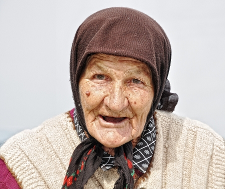 Very old woman with expression on her face photo