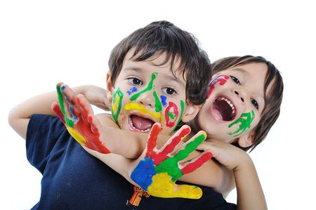 fingerpaint: A little cute child with several colors on white