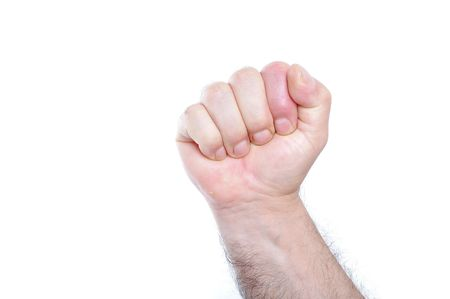 A male fist on white isolated background, number Stock Photo - 5730916