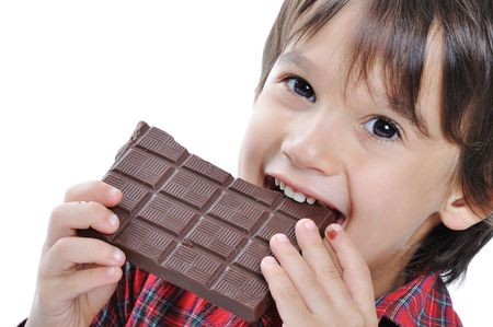 Very cute kid with chocolate, isolated photo