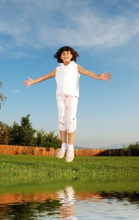 Happy girl jumping in nature   photo