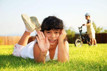 Happy children on beautiful green meadow photo