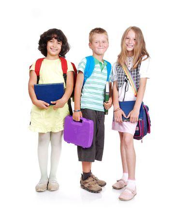 Group of three school children isolated photo