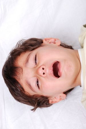 Kid crying on white sheet Stock Photo - 5781806