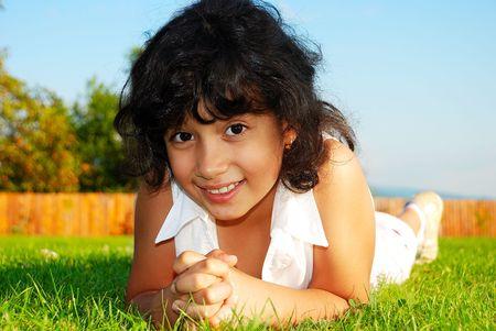 Happy girl on beautiful green meadow Stock Photo - 5781792