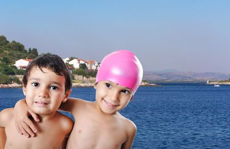 snorkelers: Happy two kids huging each other, interesting scene
