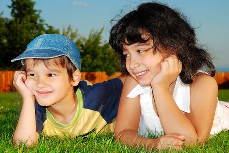 Two happy children on meadow photo