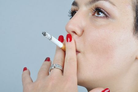malign: Young woman smoking Stock Photo