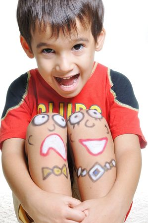 Positive kid with arts on his body photo