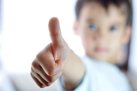 Kid with thumb up photo