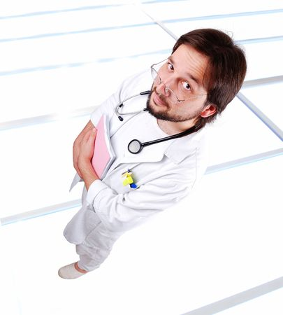 Young positive doctor on his workplace Stock Photo - 5897863