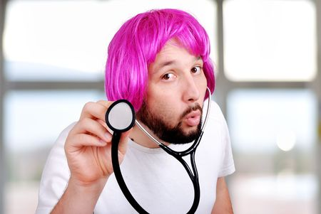 periwig: Young positive doctor on his workplace Stock Photo