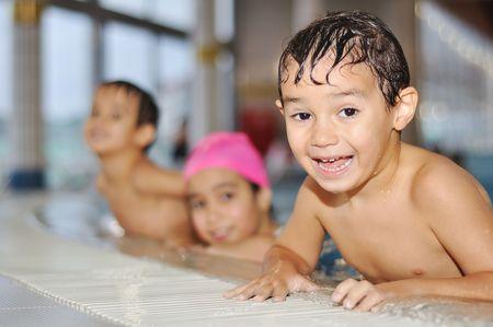 baby swimming: Children activities on very nice swimming pool Stock Photo