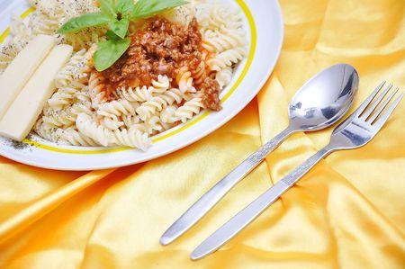 Italian macarony with original ingredients, on golden fabric Stock Photo - 5870717