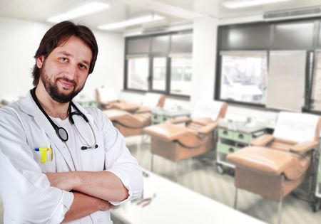 Young positive doctor on his workplace Stock Photo - 5853191