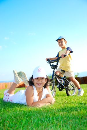 Children playing on green meadow, nice scene photo