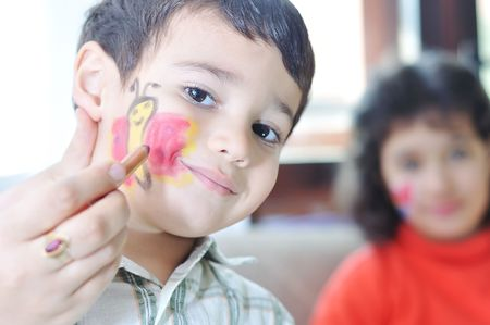 Positive kid with colors on his face and body Stock Photo - 5887245